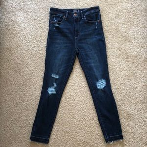 High rise distressed jeans with frayed hem